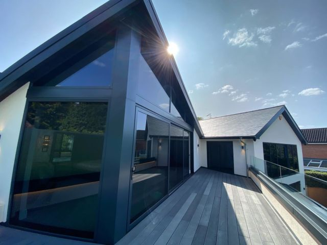 Our large mapperley job is nearing completion, just a few client finishing touches then it's complete. Photo was taken a few weeks ago when the sun was still shining! This is the bedroom balcony, 30sq/m composite @millboardflooring, glass frameless balustrade, rebated led lighting, galvanised guttering, Spanish slate, vaulted aluminium windows and aluminium doors, @sgweberuk render. Excited to get the final internal pictures done, details are on point 👌🏻 #nottinghambuilders @gibbsanddandynottingham @federationofmasterbuilders @millboard_decking @sgweberuk #siliconerender #aluminiumwindows #aluminiumdoors #millboarddecking #sitesnaps @jewsonuk